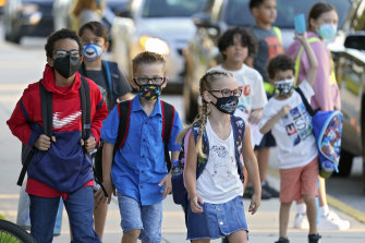 Primary school children return to school in Florida, United States, in August after their summer holiday.