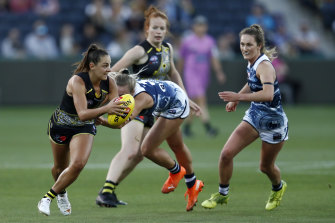 Richmond's Monique Conti looks to get the ball away against Geelong.