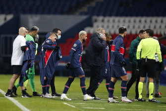 Players leave the pitch in the Champions League match between PSG and Basaksehir after anger at an alleged racial slur from a fourth official.