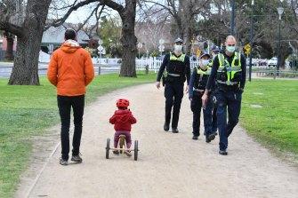 Police patrol Princes Park in Carlton on Tuesday morning.