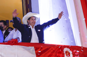 Newly Elected President of Peru Pedro Castillo waves at supporters.
