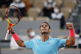 Rafael Nadal of Spain celebrates after defeating Stefano Travaglia to reach the fourth round.
