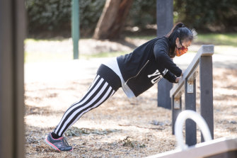 A woman works out on some outdoor gym equipment in Bentleigh.