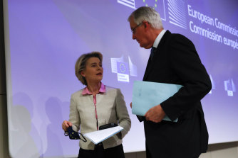 Michel Barnier, right, speaks with European Commission President Ursula von der Leyen after the deal was announced.