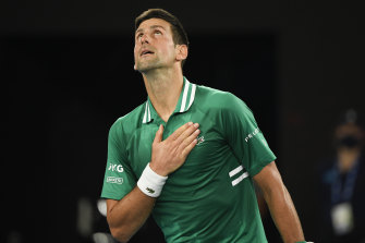 Novak Djokovic celebrates after advancing through to the semi-finals at the Australian Open.