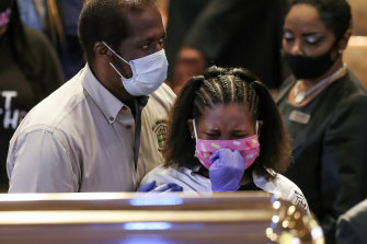 Mourners react as they visit the casket of George Floyd in Houston on Monday.