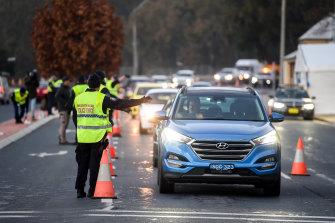 NSW Police direct traffic at the Albury-Wodonga border last month.