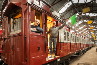 All aboard: Tom Clark, left, and twin brother Kevin in the Red Rattler train at Newport railway workshops.