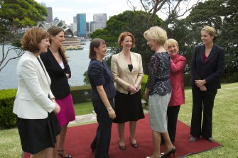 A different world: Governor-General Quentin Bryce speaks to female ministers in Julia Gillard's government, including Kate Ellis (second from left), after their swearing-in at Admiralty House in 2011.