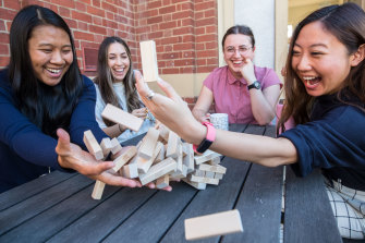Access Health mental health and alcohol and drug clinicians Yoshe Le, Gabrielle Klepfisz, Carissa Mirra and Ly-Huong Tran (left to right) playing Jenga.
