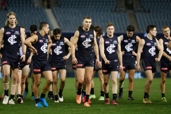 The Blues look dejected after their loss against North Melbourne on Saturday.