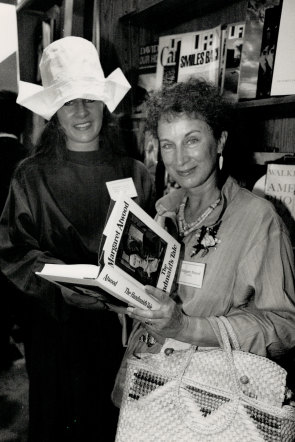 Atwood signing a copy of The Handmaid's Tale in Toronto, 1989.