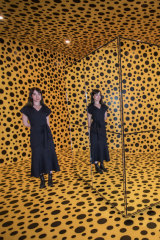 Senior Curator Jaklyn Babington in Kusama's infinity room.