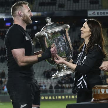 Safe for another year: Kieran Read receives the Bledisloe Cup from New Zealand Prime Minister Jacinda Ardern.