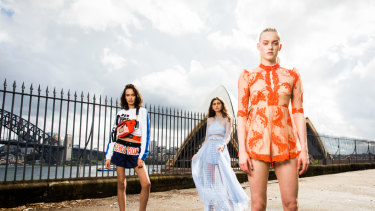 Models wear looks from designers showing at this year's MBFWA including Alice McCall, orange dress far right, We are Kindred, centre, and P.E Nation on the left.