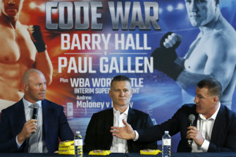 Jousting: Things heat up between Barry Hall and Paul Gallen while Danny Green watches on at their joint press conference at the Crown Promenade.