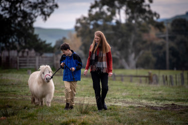 Will Callaghan walking the miniature ponies with MASS director Simone Reeves outside Mansfield.