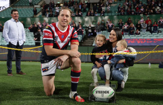 Mitchell Aubusson of the Roosters poses with his wife Laura and children after playing his 303rd match for the Roosters against the Sharks, making him the most-capped player in the club's history.