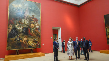 Belgium's King Philippe, centre right, and Belgium's Queen Mathilde, centre left, wear face masks, to prevent the spread of coronavirus, as they visit the Royal Museum of Fine Arts in Brussels.