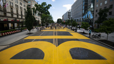 """Black Lives Matter"" is seen painted on a street in Washington, DC."