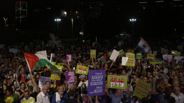 People march during a protest against the Jewish nation bill in Tel Aviv.