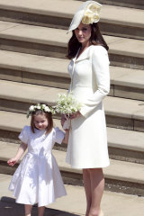The Duchess of Cambridge and Princess Charlotte arrive at the wedding of Prince Harry and Meghan Markle on Saturday.
