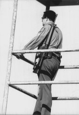 A policeman mans a watch tower at Long Bay on August 19, 1979.