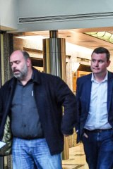 Australian Workers Union boss Ben Davis (left) and state MP Tim Richardson leave an MP's office recently after peace talks.
