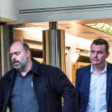 Australian Workers Union boss Ben Davis and state MP Tim Richardson leave Kim Carr's office after the peace talks.