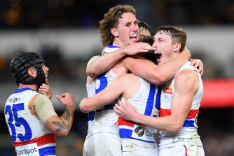 Western Bulldogs players celebrate after the thrilling win over the Lions.