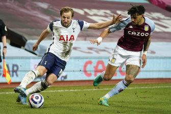 Harry Kane looks to take the ball past Aston Villa's Tyrone Mings.