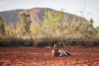 Hundreds of Indigenous people travelled up to 1500km to celebrate the closure of the Uluru climb.