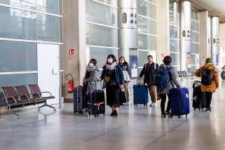 Travellers arriving at Charles de Gaulle Airport in Paris. The man who died in Paris from coronavirus on Friday was an elderly Chinese tourist.