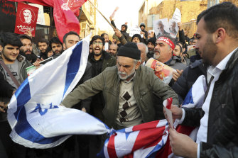At protest outside the British embassy in Tehran, demonstrators burnt British and Israeli flags.