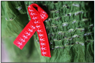 The red ribbon has been the symbol for AIDS-HIV support for decades.