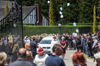 Balloons were released at the end of the service, which was held in the gardens of a reception center in Whittlesea.