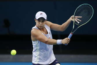 Ashleigh Barty plays a backhand in her fourth-round match against American Shelby Rogers on Monday night.