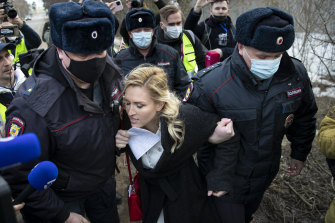 Police officers detain Dr Anastasia Vasilyeva outside the prison where Alexei Navalny is being held.