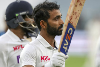 A restrained Ajinkya Rahane celebrates what could prove a crucial century at the MCG.