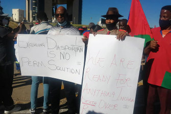 People stage at protest in Windhoek, Namibia on Friday.