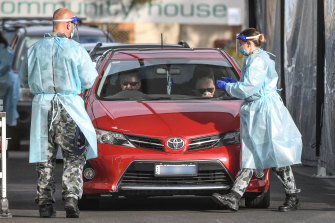 Australian Defence Force members, in uniform, joined Victorian health workers at testing sites in Melbourne on Saturday.