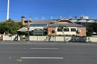 The Gabba looms over East Brisbane State School, at the intersection of Wellington Road and Vulture Street in Woolloongabba.