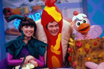 Daryl Somers with co-host Jacki MacDonald and Ossie Ostrich on Hey Hey It's Saturday in 1987.