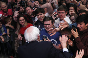 Supporters of democratic presidential candidate Bernie Sanders at a campaign rally on Saturday in Cedar Rapids, Iowa.