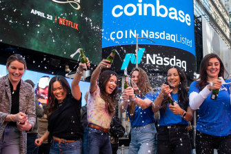 Coinbase employees celebrate during the company's initial public offering outside the Nasdaq MarketSite in New York.