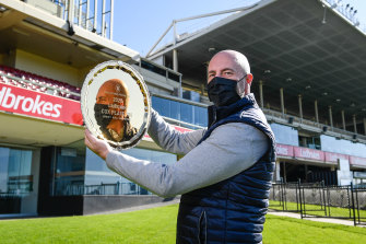 Moonee Valley Racing Club chief executive Michael Browell with the gold 100th Cox Plate.