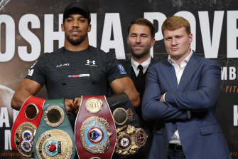 Britain's Anthony Joshua (left) and Russia's Alexander Povetkin (right) with promoter Eddie Hearn before a title fight in 2018.