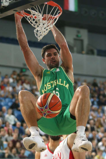 Emphatic: Todd Blanchfield of Australia dunks.
