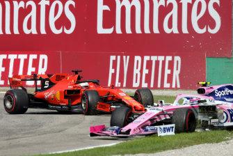 Lance Stroll's Mercedes is collected by the Ferrari of Sebastian Vettel.