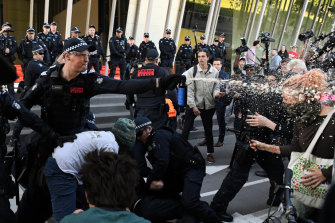 The activists faced off against police, who used capsicum spray on the crowd on Tuesday.